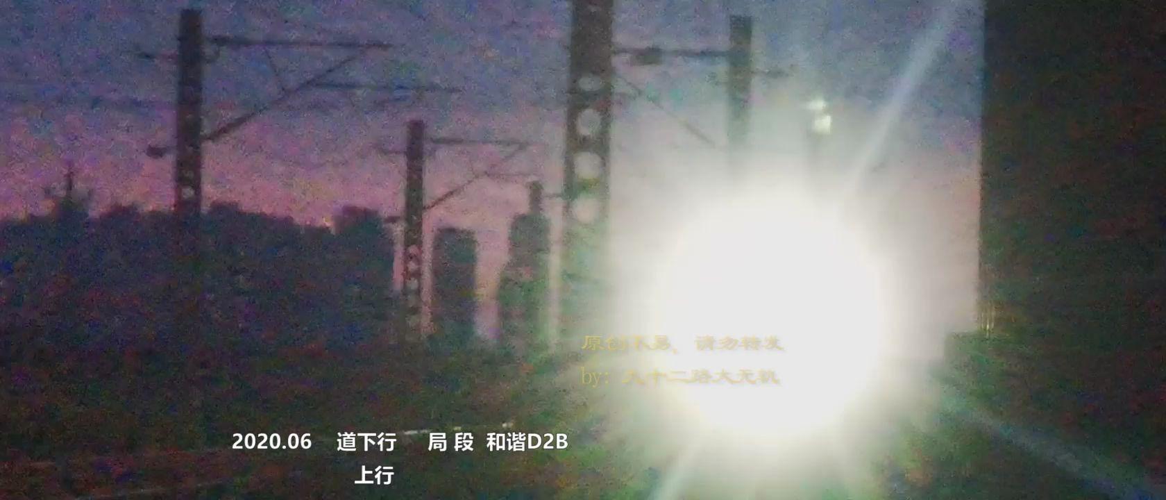 昏暗的桥下,北环线上从山岭子过来的直通货列,即将进天津北塘西站
